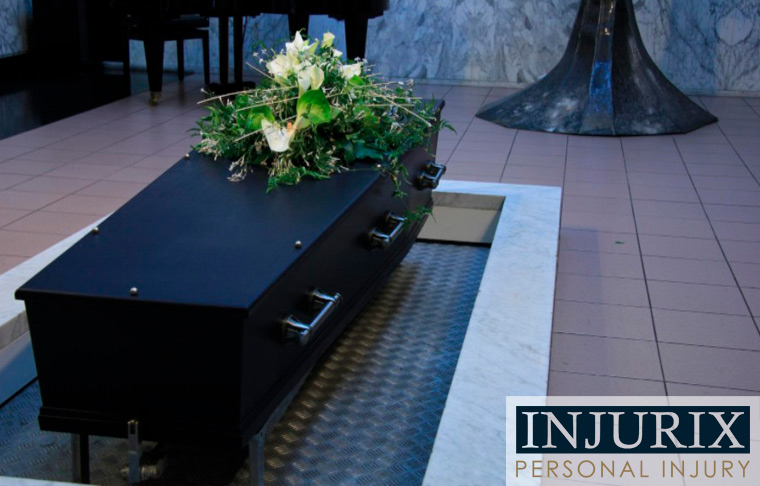 black casket with white flower bouquet on top