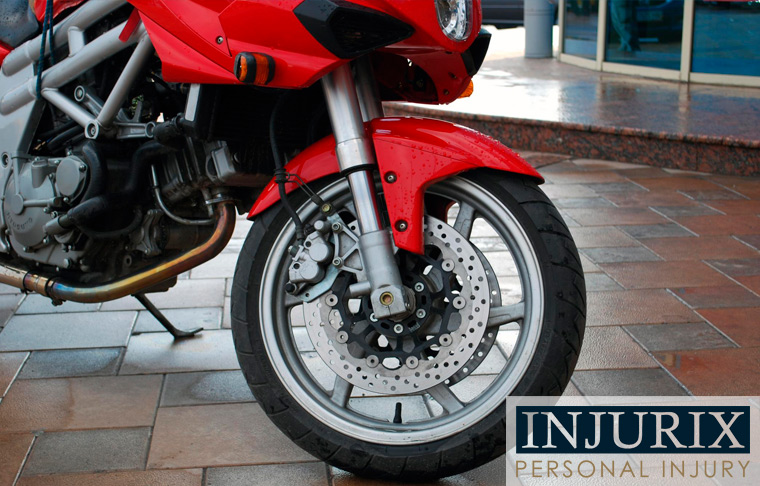 image of front wheel of a red sport motorcycle