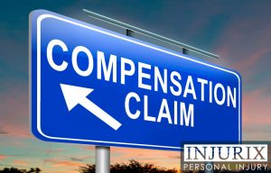 "blue sign that reads ""Compensation Claim"""